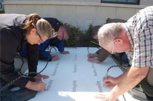 49-midwayusa-employees-engrave-9-company-values-in-campus-sidewalks-300x199.jpg