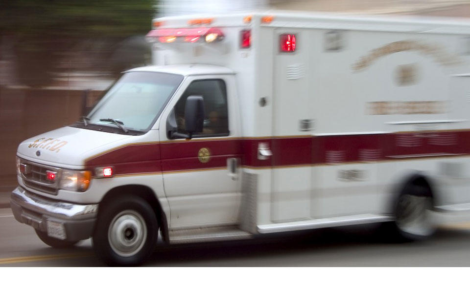 white ambulance with red trim and letters on side