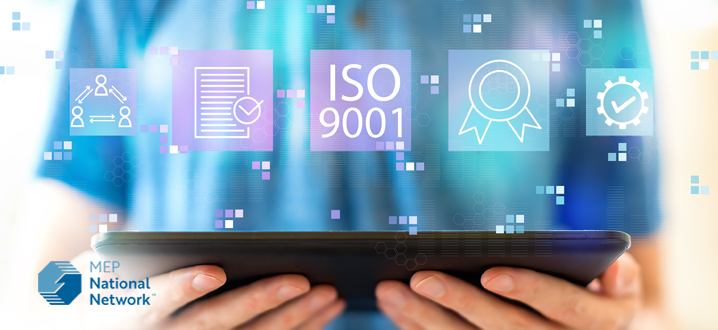 ISO 9001 with man using a tablet stock photo