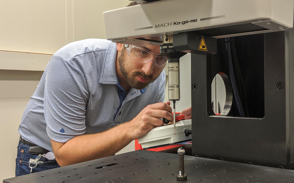 man operating a coordinate measuring machine