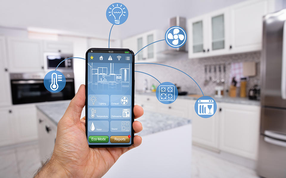 a photo of a phone with various icons showing the household appliances and systems that it can control via the internet