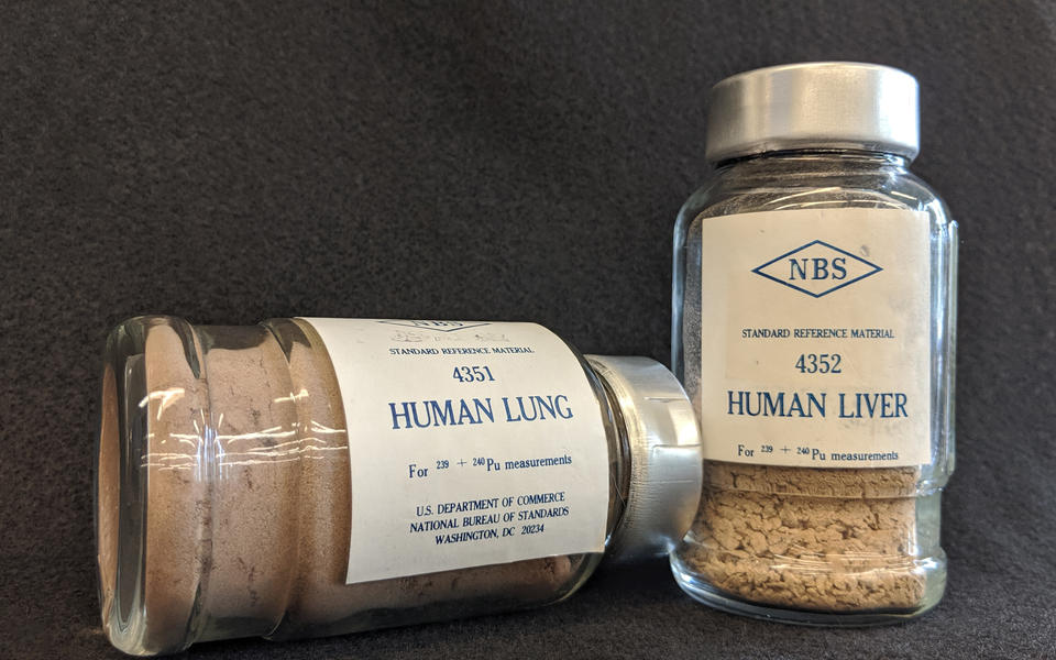 a photo of two bottles about the size of spice bottles. On one is written 4351 Human lung for 239+240 Pu measurements, and on the other is written 4352 Human liver for 239+240 Pu measurements