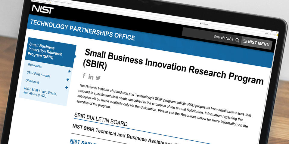 Image of a laptop displaying the SBIR website