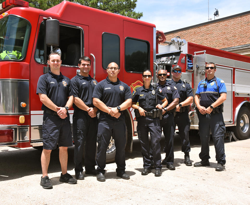 Emergency Services employees from the City of Germantown, TN standing in front of the fire truck at the station.