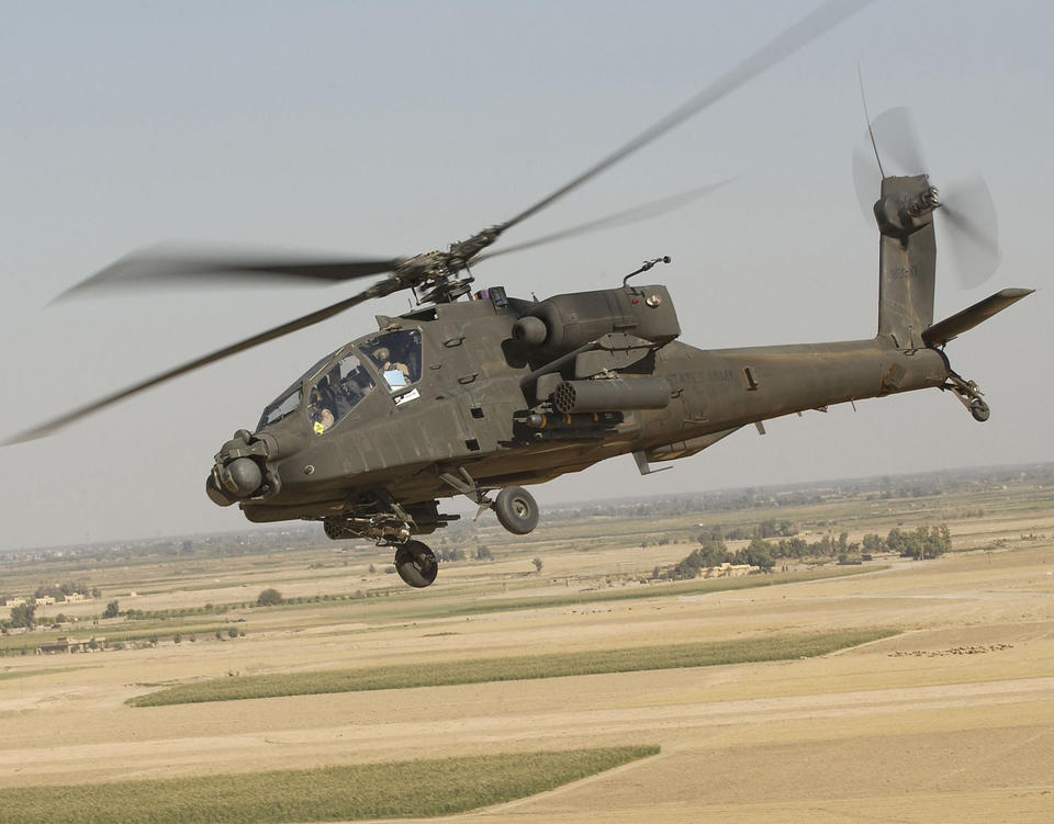 Apache helicopter flies near the ground