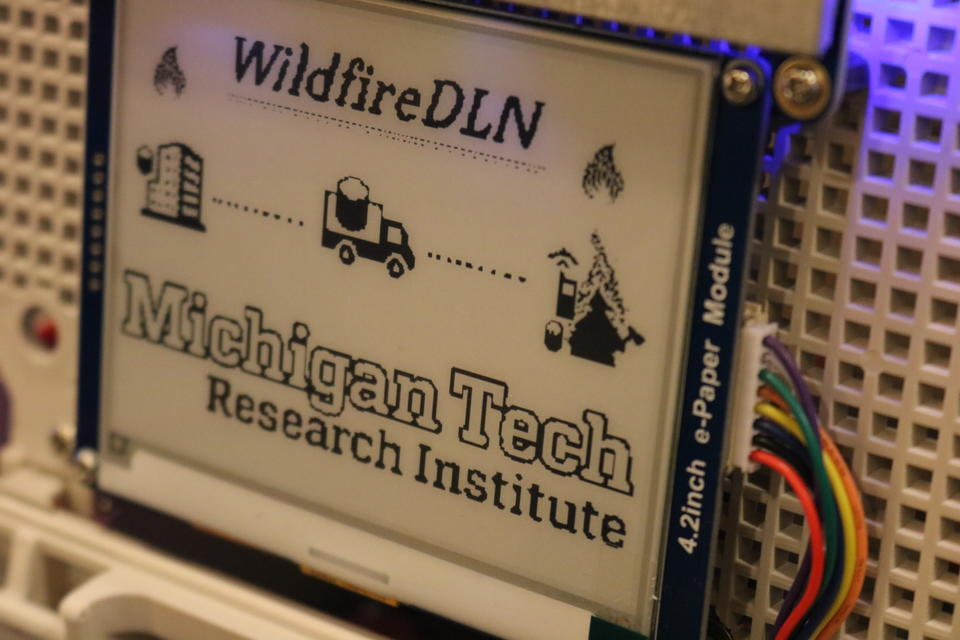 "Shows the Michigan Tech data ferry, printed text reads ""Wildfire DLN Michigan Tech Research Institute"""