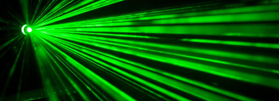 Image green laser beams against a black background