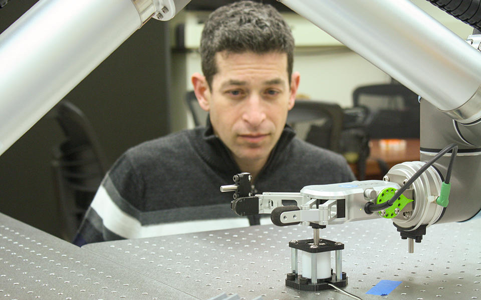 Brian Weiss overseeing his robot's operation