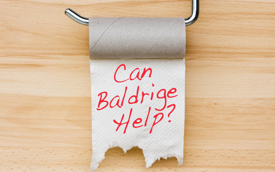 An empty toilet paper holder asking can Baldrige help?