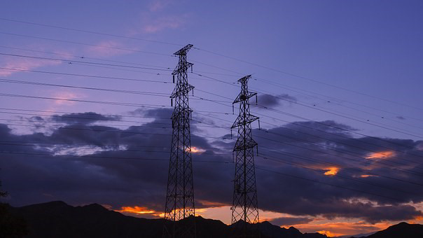 Image of power lines after dark