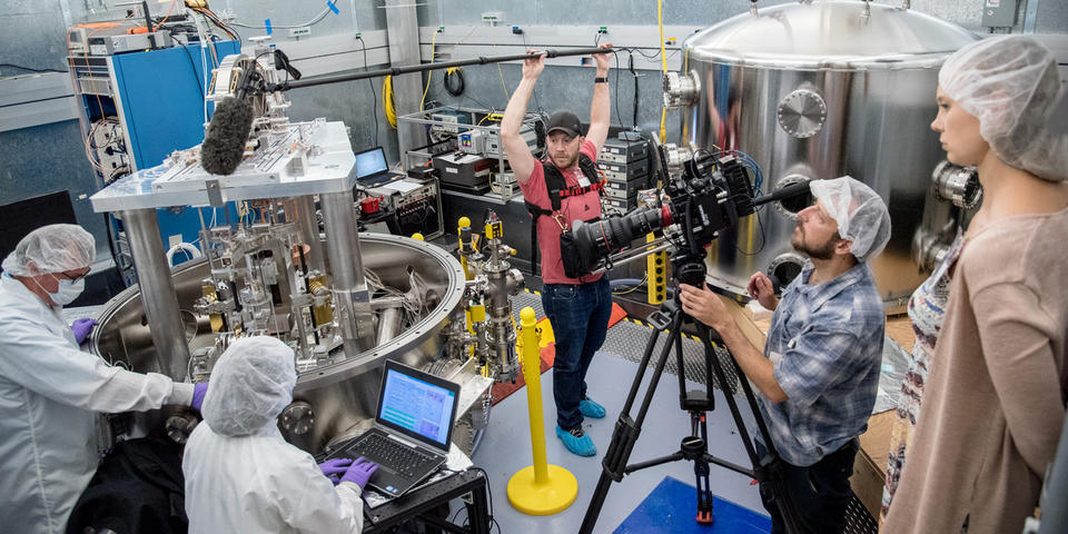 Film crew films a pair NIST researchers operating the NIST Kibble balance