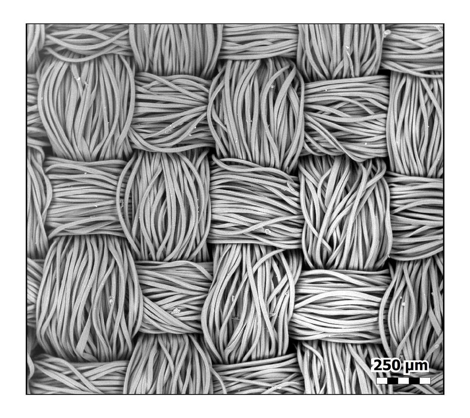 Bundles of polyester fibers in a crisscross pattern