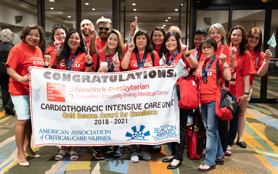 Photo of staff at the American Association of Critical-Care Nurses congratulating the Cardiothoracic Intensive Care Unit for being the 2018-2021 Gold Beacon Award for Excellence winner.