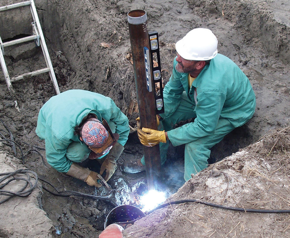 MESA Products, Inc. photo of employees installing a cathodic protection system.