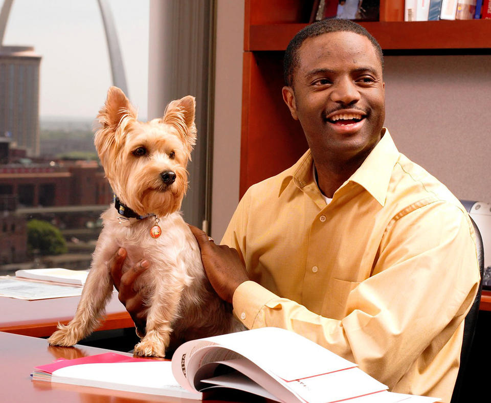 Nestlé Purina PetCare Company photo of employee with their dog at work.