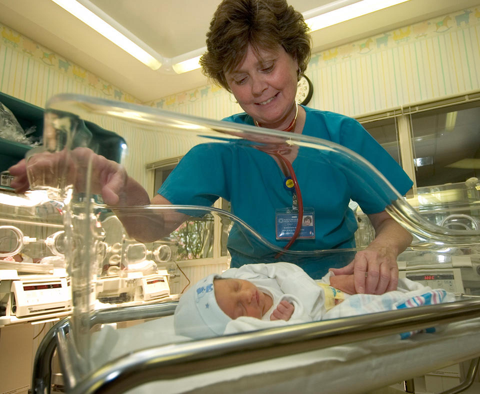 North Mississippi Medical Center photo of nurse with newborn.