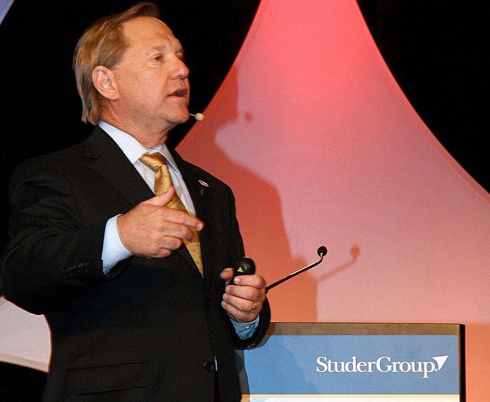 Studer Group photo of man speaking at podium.