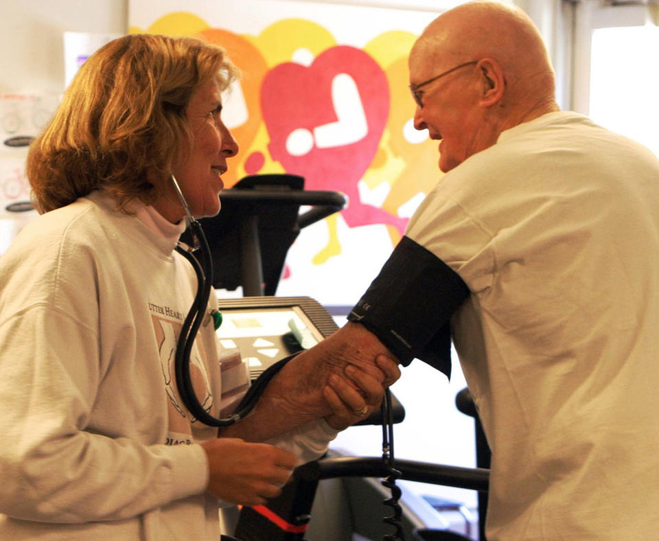 Sutter Davis Hospital photo of nurse taking blood pressure of patient.