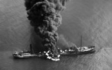 aerial view of the oil tanker Byron D. Benson ablaze after a U-boat attack