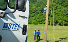 BTES of workforce on location climbing an electric pole.