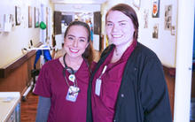 Two female nurses standing together in a hospital who graduated from Tri County Tech.