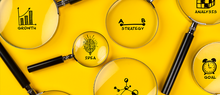 business plan concept with icons and magnifying glasses