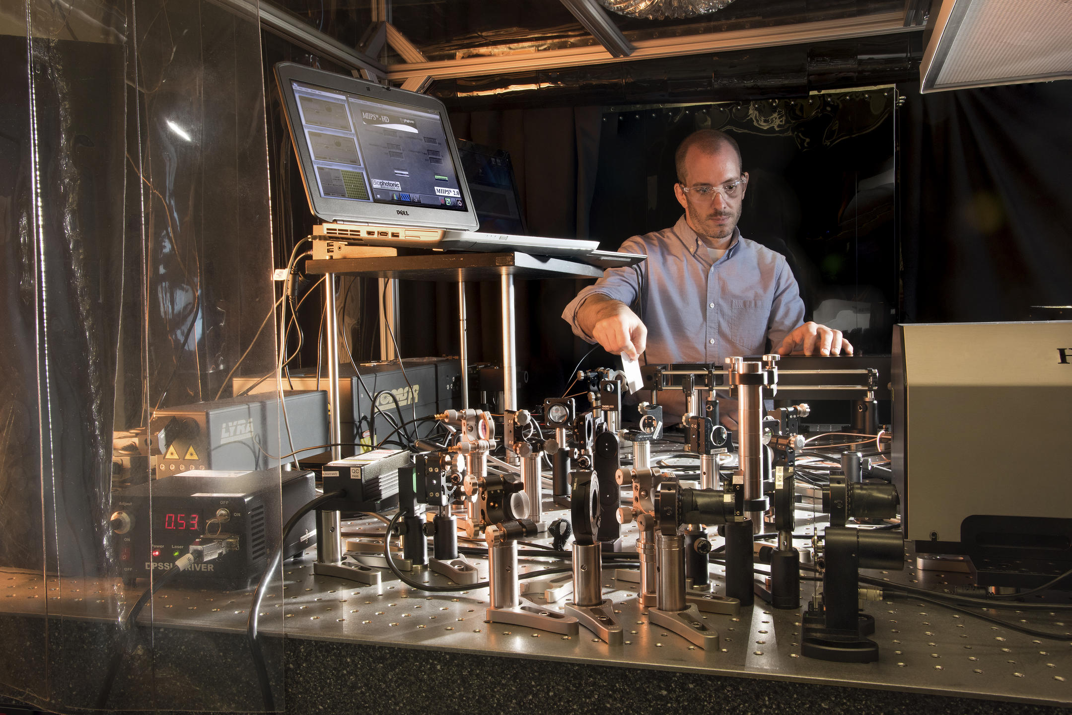 Researcher John Bender setting up a laser table in a laboratory