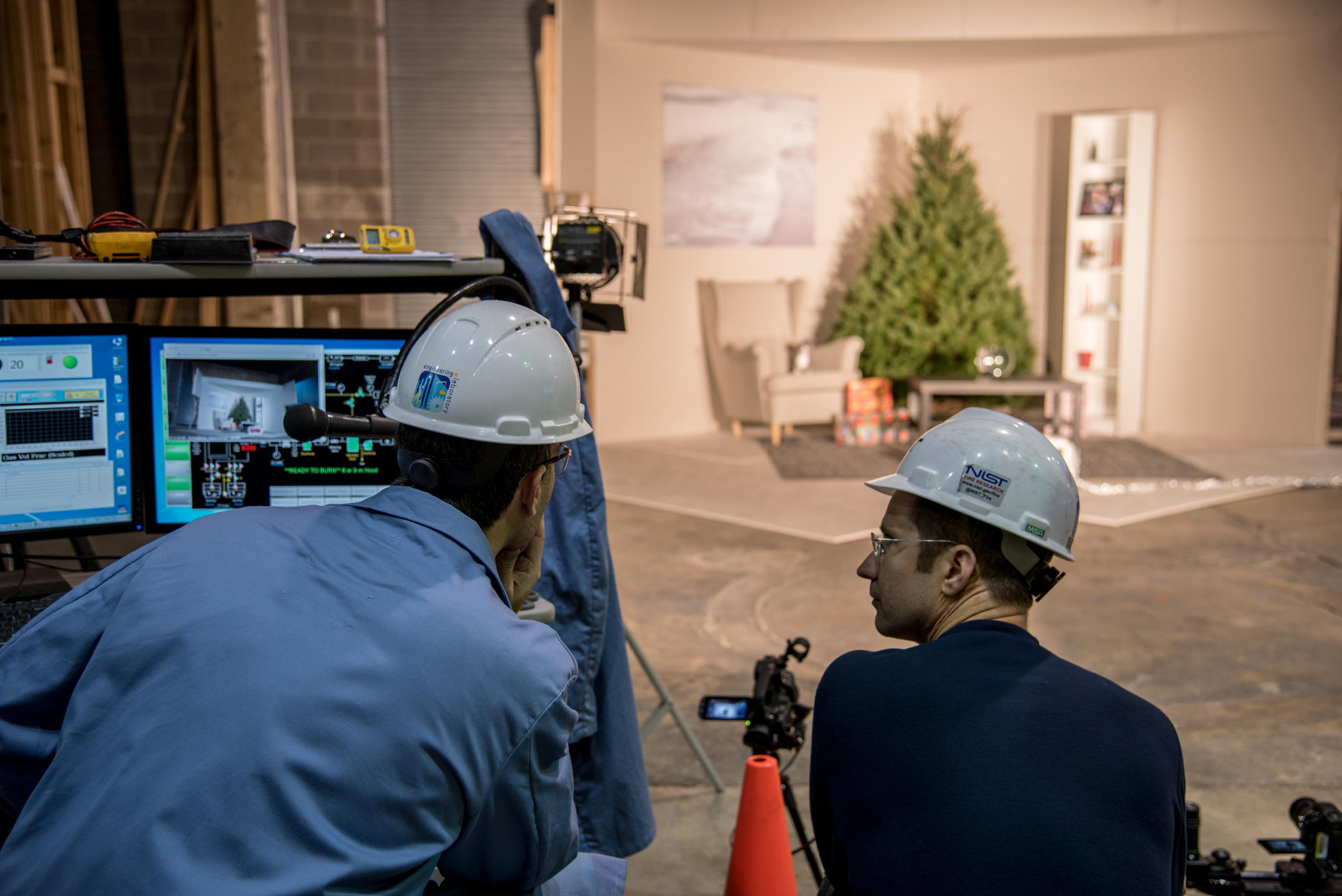 Two engineers observe the scene for the Christmas tree burn