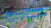 Displays an image from the Boston Marathon with Spectronn's tech overlaid.