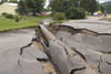Photo of damage to a road caused by a 2007 flood in Minnesota