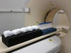 diapers going into a CT scan
