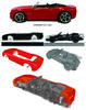 Various pieces of a red Hot Wheels car.