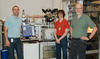 Jabez, McClelland, Adam Steele and Brenton Knuffman pose in their lab with their cesium ion source.