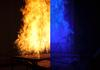 In this photo, we see a split-screen image of a laboratory fire. The left side shows the fire obscuring the view of an object behind it while the right side shows the same object with the clarity dramatically enhanced using ordinary blue light.