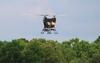 multi-bladed drone in flight