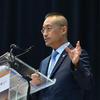 Sokwook Rhee speaking at a podium