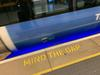 "image of a subway train as it rushes past, the words ""mind the gap"" appear on the subway platform"