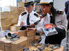 Image of 2 security officers inspecting packages