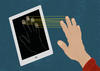 A mobile device scans the fingerprints of a hand held close to the screen.