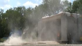 Test 3: Dispersion and Burning Behavior of Hydrogen Released in a Full-Scale Residential Garage in the Presence and Absence of Conventional Automobiles (View of garage exterior from HD camera) Thumbnail