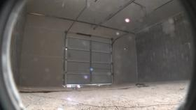 Test 3: Dispersion and Burning Behavior of Hydrogen Released in a Full-Scale Residential Garage in the Presence and Absence of Conventional Automobiles (View of garage interior from floor camera) Thumbnail